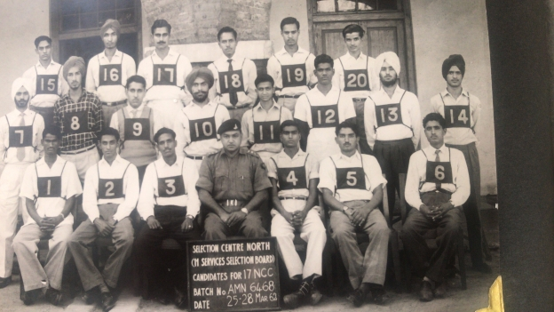 H.M. Singh (Standing - 2nd from Right, with #13 tags)