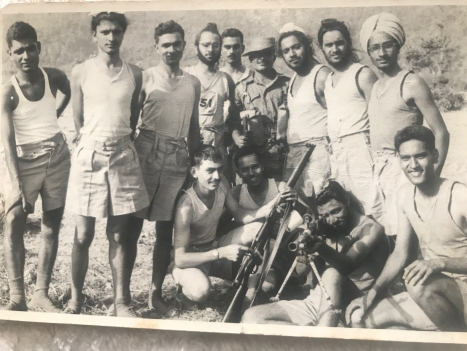 H.M. Singh (Standing, 2nd from Right)